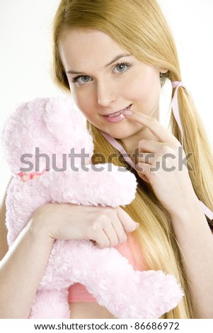 portrait of woman with teddy bear - stock photo