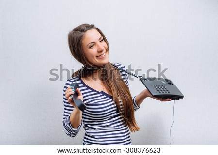 portrait of woman with telephone cord wrapped around neck - stock photo