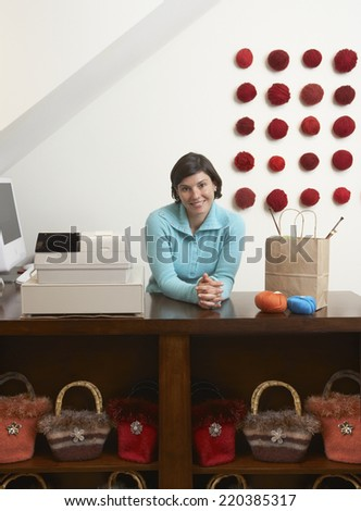 Portrait of woman working in boutique - stock photo