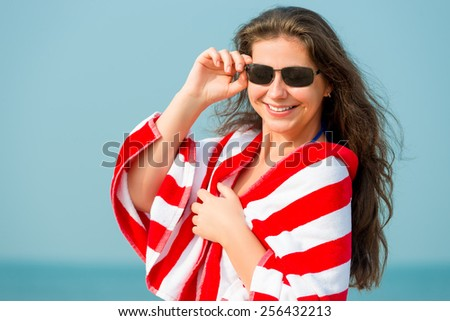 portrait of woman 30 years resting on the beach - stock photo