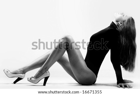 Portrait of wonderful woman sitting in perfect pose - stock photo