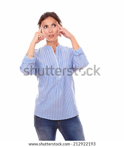 Portrait of wondering latin woman looking left up while standing on isolated white background - copyspace - stock photo