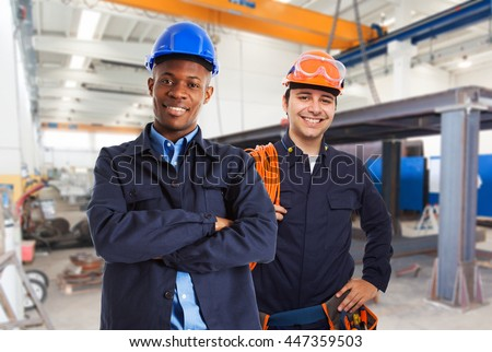 Portrait of workers in a factory - stock photo