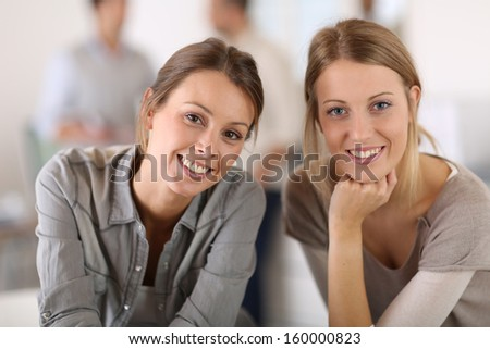 Portrait of working girls in office - stock photo