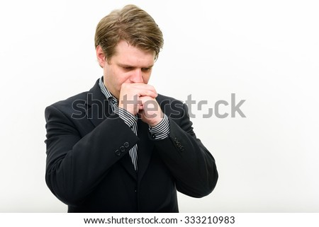 Portrait of worried businessman - stock photo