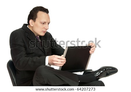 Portrait of worried businessman looking in his laptop. Studio shot, isolated on white - stock photo