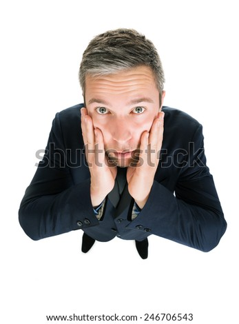 Portrait Of Worried Businessman Over White Background - stock photo