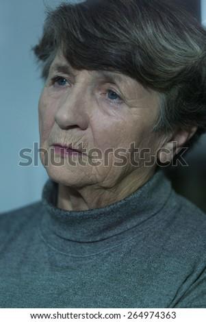 Portrait of worried elder woman having depression - stock photo