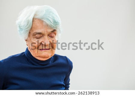 Portrait of worried senior woman  - stock photo