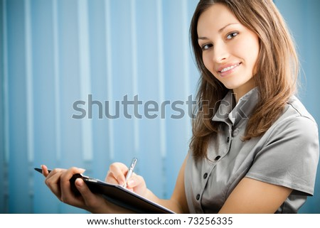 Portrait of writing happy smiling businesswoman working at office. You can use left part for slogan, big text or banner. - stock photo