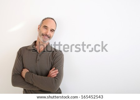 Portrait of 50-year-old man standing on white background - stock photo