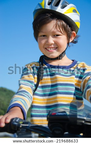Portrait of 8 years old boy on a bike - stock photo