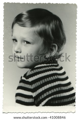 Portrait of 4-years-old boy posing in the studio; old photo taken in 1977 - stock photo