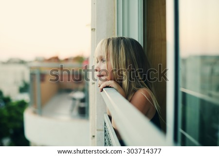 Portrait of 5 years old girl looking to the street - stock photo