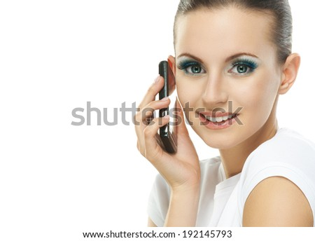 Portrait of young adorable smiling woman talking on telephone against white background. - stock photo
