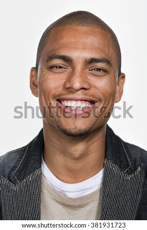 Portrait of young adult African American man - stock photo