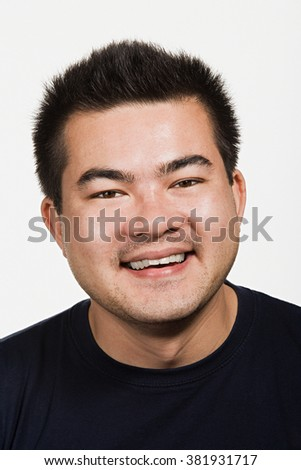Portrait of young adult Asian man - stock photo