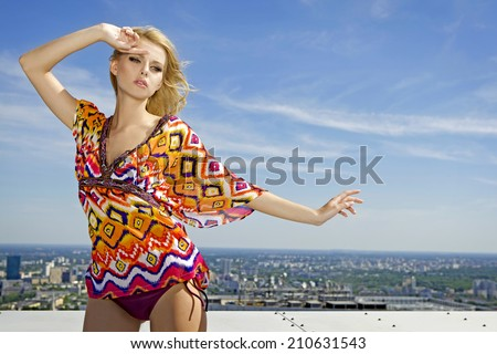 portrait of young adult beautiful and sensuality blonde girl on background blue sky - stock photo