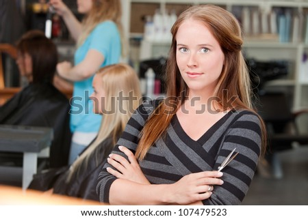 Portrait of young adult hairstylist . - stock photo