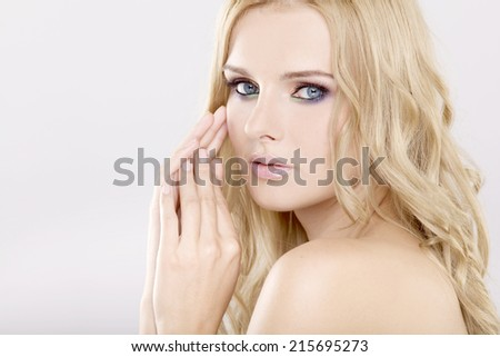 Portrait of young adult pretty and sensuality woman with beautiful blond hairs and multicolor makeup isolated on white background - stock photo