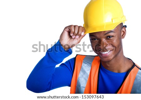 Portrait of young African-American male construction worker tipping his hardhat, studio shot - stock photo