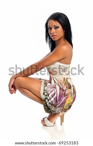 Portrait of young African American woman posing isolated over white background - stock photo