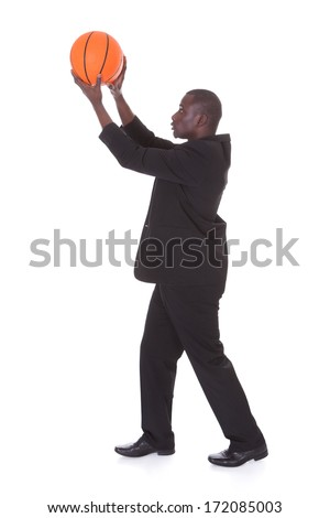Portrait Of Young African Businessman Holding Basketball - stock photo