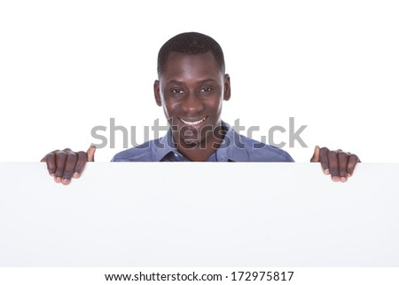Portrait Of Young African Holding Blank White Board - stock photo