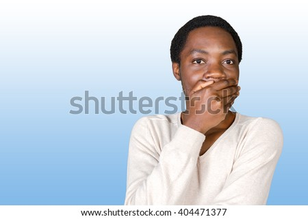 Portrait Of Young African Man Covering Mouth - stock photo