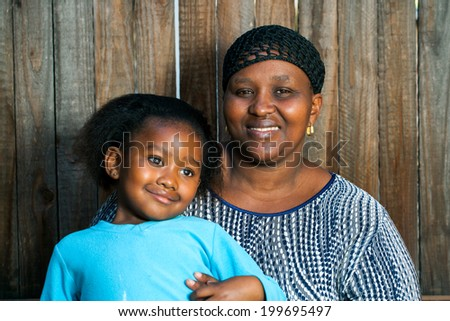 Portrait of young African mother with little daughter. - stock photo