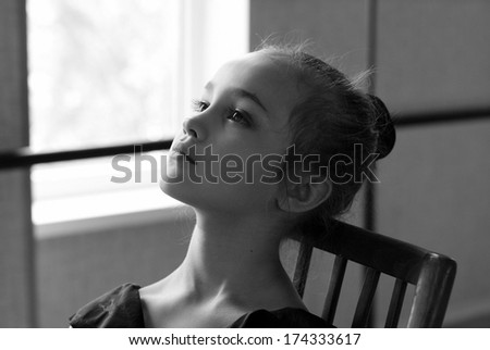 Portrait of young and beautiful ballet dancer in dance studio. Black and white art photo with bokeh and grain - stock photo