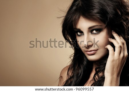 Portrait of young and beautiful brunette - stock photo