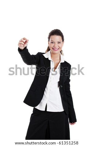 Portrait of Young and beautiful businesswoman holding keys - stock photo