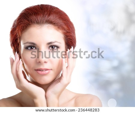Portrait of young and beautiful Woman over winter Christmas background.Spa - stock photo