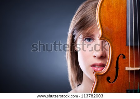 Portrait of young and beautiful woman with a violin - stock photo