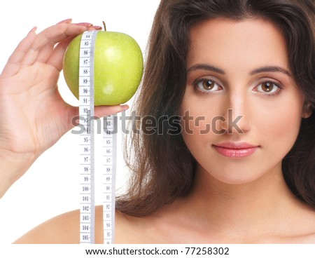 Portrait of young and sexy brunette with an exotic fruit - stock photo