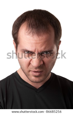 portrait of young angry man  isolated on white background - stock photo