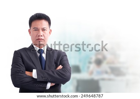 Portrait of young asia business man 30 - 40 year old has office background .cross one's arm,Positive emotion - stock photo