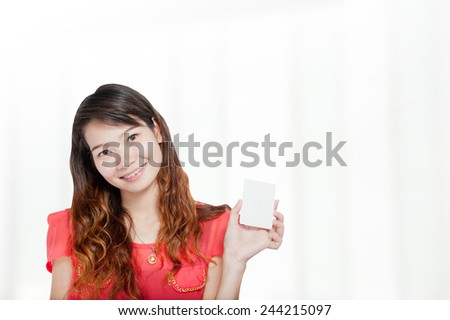 Portrait of young asia business woman  hold card in her office.Mixed Asian / Caucasian businesswoman. - stock photo