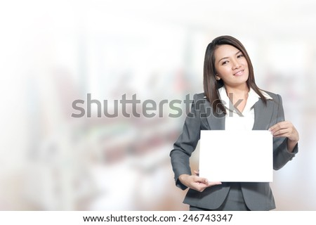 Portrait of young asia business woman 20 -30 year hold banner old in her office.Mixed Asian / Caucasian businesswoman.Positive emotion - stock photo