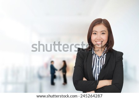 Portrait of young asia business woman 20-30 year old in her office.Mixed Asian / Caucasian businesswoman.Positive emotion - stock photo