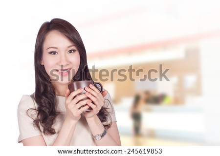 Portrait of young asia business woman 20 - 30 year old in her office.Mixed Asian / Caucasian businesswoman. - stock photo