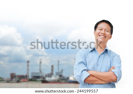 portrait of young asia businessman has oil industry. - stock photo