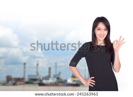 portrait of young asia businesswoman showing ok sign has oil industry.office.Mixed Asian / Caucasian businesswoman. Positive emotion - stock photo