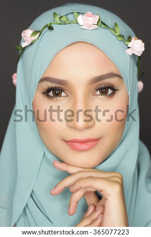 portrait of young asian beautiful muslimah woman posing for a camera - stock photo