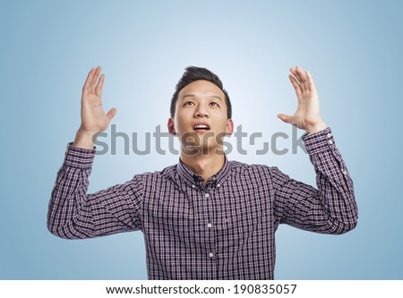 portrait of young asian man asking to the sky - stock photo