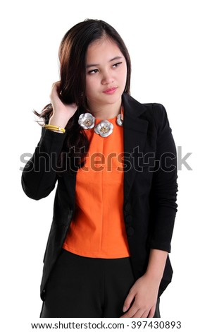 Portrait of young Asian woman in business suit looking sideways, isolated on white background - stock photo