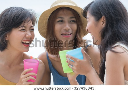 portrait of young asian woman with happiness emotion and beverage cup in hand laughing and  joyful use for people relaxing vacation on destination - stock photo