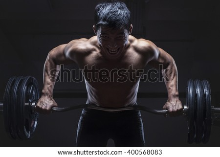 portrait of young athlete lifting the barbell  - stock photo