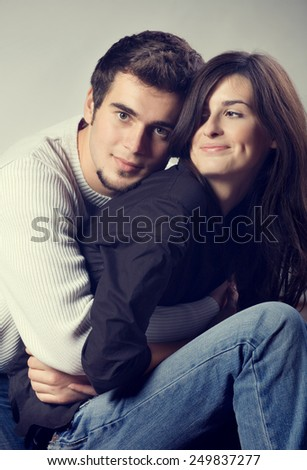 Portrait of young attractive couple - stock photo